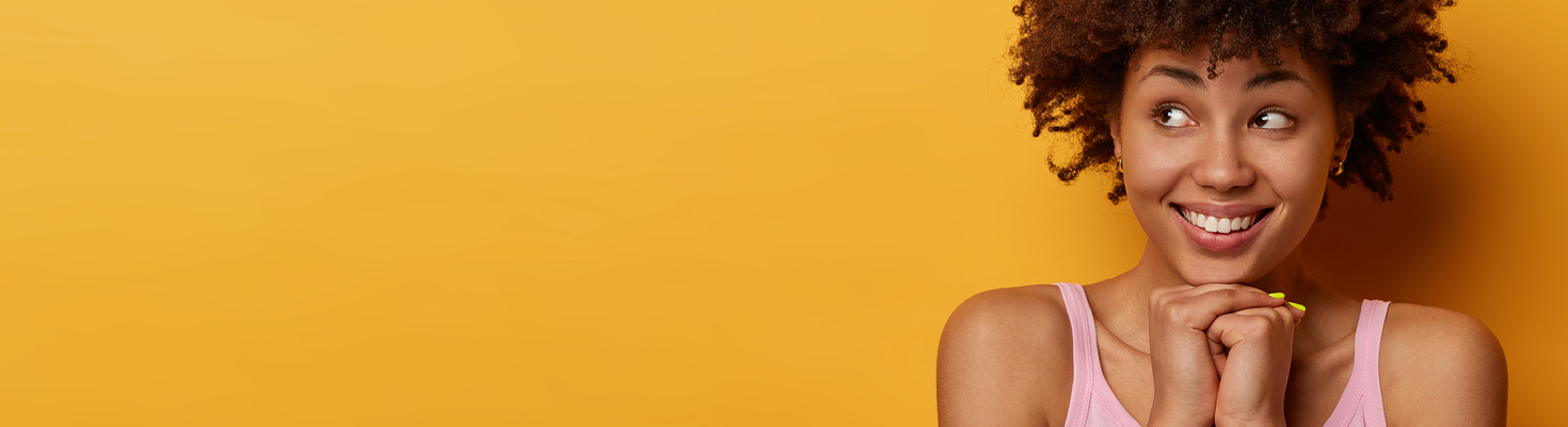 reward yourself with free checking. Excited young woman against a yellow backdrop.